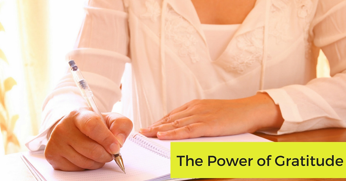 women writing in book gratitude